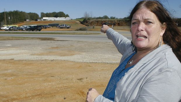 Menacing ... Ronda Wilbur, a neighbour of  Jimmy Lee Dykes, points as she speaks with the media about encounters she's ...