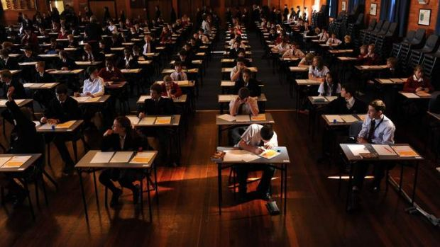 Tunnel vision ... Year 7 students at Daramalan College in Canberra sit the NAPLAN test.