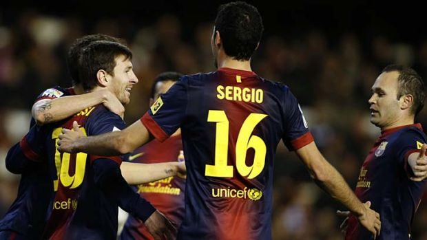 Lionel Messi celebrates with teammates after scoring.
