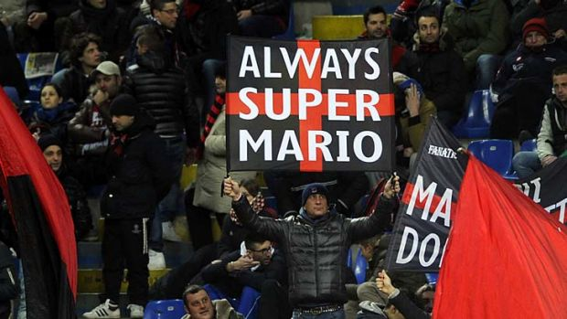 AC Milan supporters welcome Mario Balotelli.