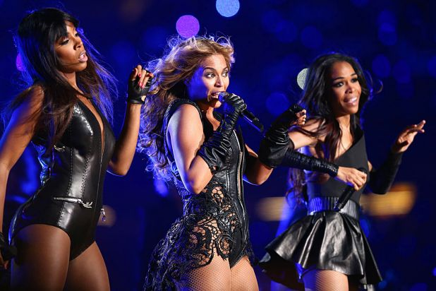 Beyonce Knowles (centre) is joined on stage by her Destiny's Child bandmates Kelly Rowland (left) and Michelle Williams.
