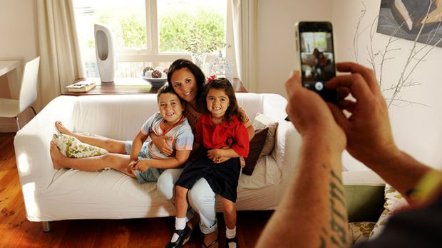 Dad Sean takes a happy snap of Tiarni, mum Rose and brother Aiden ahead of Tiarni's first day of kindergarten.