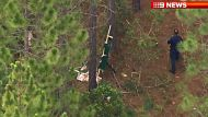 A pilot is killed in an ultralight crash in the Glass House Mountains north of Brisbane