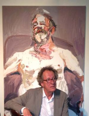 Geoffrey Rush with the portrait of Billie Brown, which he has loaned to the Bille Brown Studio in South Brisbane.