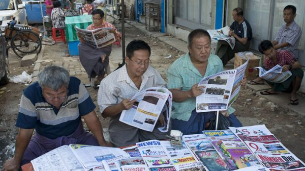 Burmese men read the morning papers.