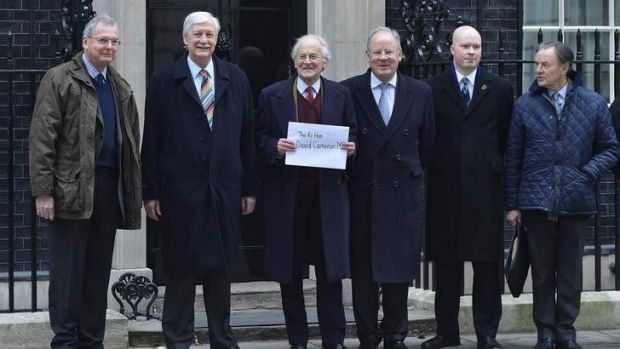 Against the move ... Senior Conservatives with a letter addressed to David Cameron.