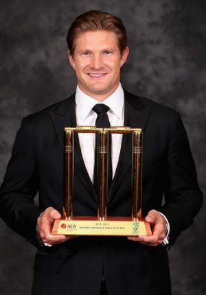 A golden pair: Shane Watson with his trophy.