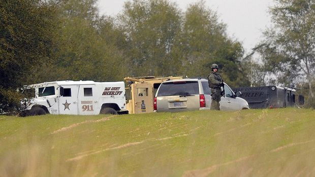 Armed law enforcement personnel at the property of Jimmy Lee Dykes.