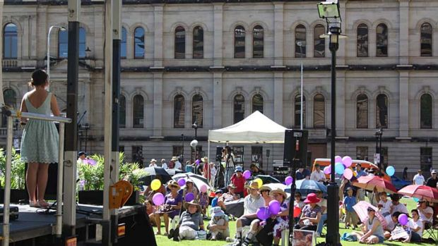 A woman speaks to pro-choice advocates at a protest in Brisbane.