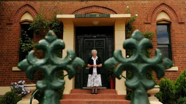 Sister Joy Mary Edwards in front of Benedict House.