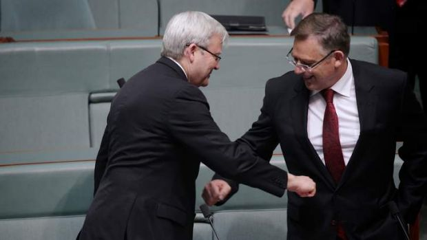 Labor MPs Kevin Rudd and Anthony Byrne greet each other with air-punches at the start of Question Time.