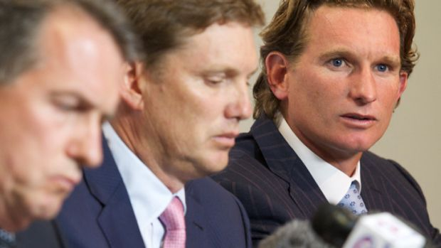 James Hird, right, fronts the media.