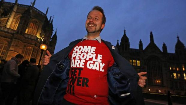 A campaigner demonstrates outside the British parliament, which has voted to legalise same-sex marriage.