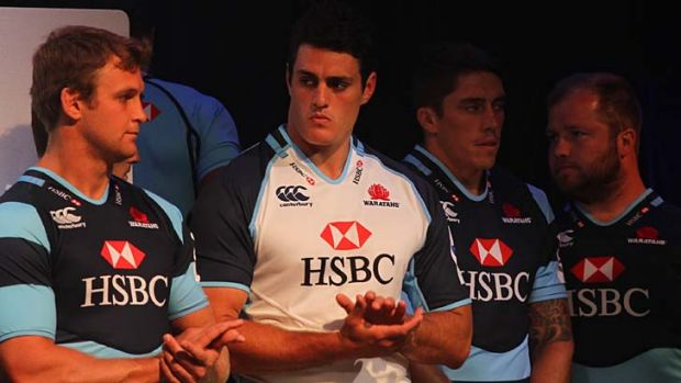 Surprise title … NSW captain Dave Dennis, in white, at the Waratahs season launch on Wednesday.