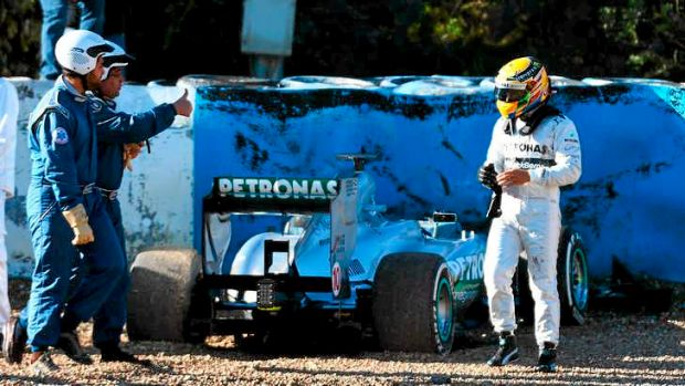 Gravel dash ... Lewis Hamilton walks away from his Mercedes after crashing into the gravel.