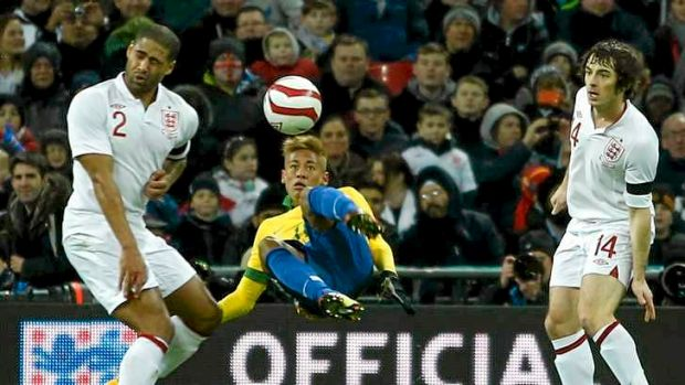 Brazilian striker Neymar attempts an overhead kick past Glen Johnson (L) and Leighton Baines  of England.