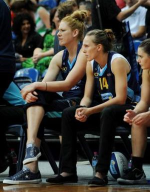 An injured Lauren Jackson and Mikaela Dombkins sit on the sidelines, as the Canberra Capitals take on Dandenong Rangers ...