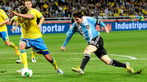 Argentina's striker and  captain Lionel Messi beats  Sweden defender Mikael Lustig during the international friendly in ...