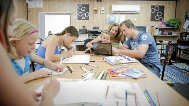 Class distinction … Guy Tebbut and Debbie Tebbut help their son Joel, while (from left) their daughters Lauren, Kasey ...