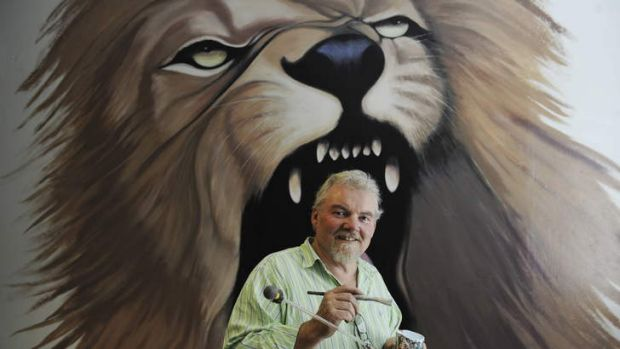 Art and craft ... Roger Robinson in front of his mural at a Drummoyne cafe.