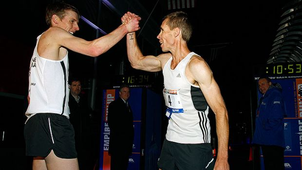 Mark Bourne of Australia congratulates Darren Wilson (R) also of Australia after the two finished first and second in ...