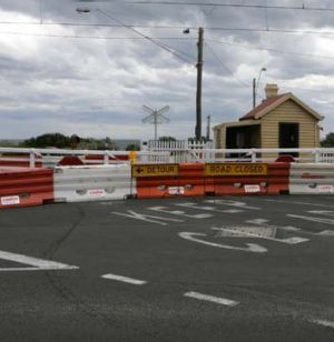 The Brighton crossing was closed after a train hit the gates.