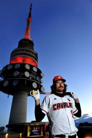 Canberra Cavalry's Jack Murphy underneath Telstra Tower on Thursday night. The tower was lit up Orange in support of the ...