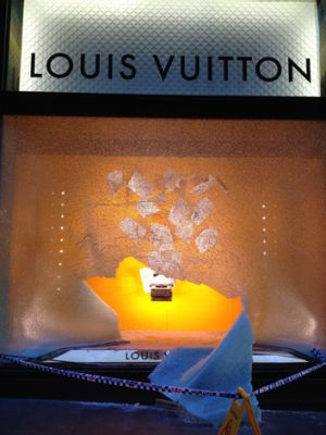 A smashed window of the Louis Vuitton store on Friday morning.