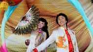 Magician Xin Ya Fei (his surname is Xin) and folk singer, Yao Xiaoqin (her surname is Yao) from China will be performing ...