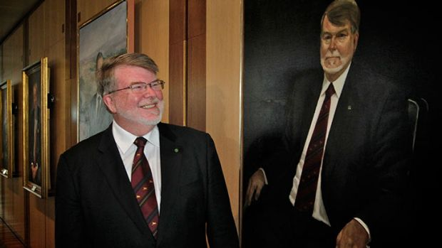 Former Speaker Harry Jenkins poses with his portrait that was unveiled at Parliament House in Canberra on Friday.