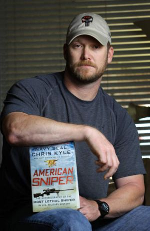Chris Kyle, a former Navy SEAL and author of the book <i>American Sniper</i> poses in Midlothian, Texas last year. (AP ...