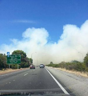 Smoke is seen billowing from a blaze near the Kwinana Freeway at Baldivis. Jamie Parker/perthweatherlive.com
