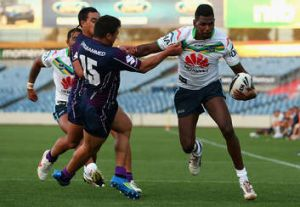 Edrick Lee tries to palm off a Storm tackler.