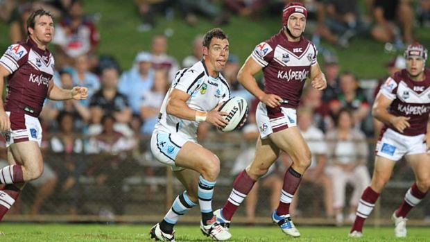 First outing … John Morris has fun on the park during the Manly-Cronulla game at Brookvale Oval on Friday night.