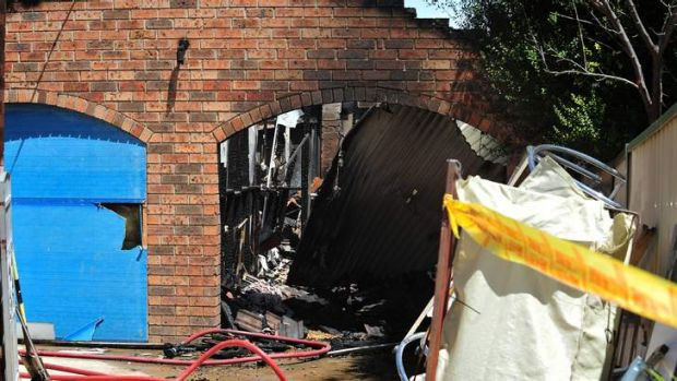 Nearby residents reported hearing explosions and the garage was well alight when fire services arrived.