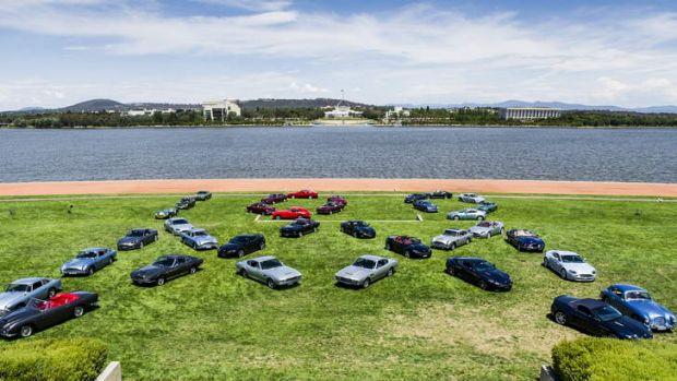 The Aston Martin Club's annual meeting, this year in Canberra, display their cars at Rond Terrace in the shapes of the ...