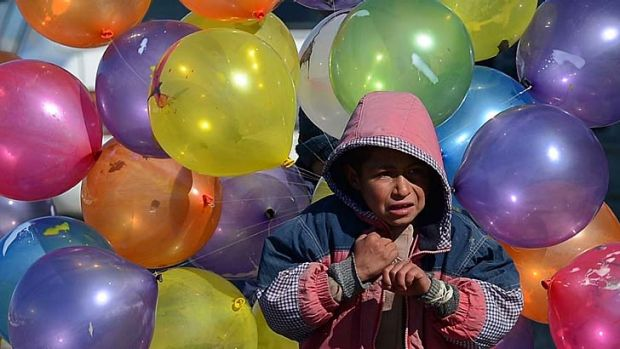 Survival … a boy sells balloons in the Afghan capital, Kabul, last week. US-led forces in the country are accused ...