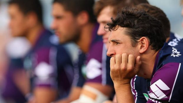 Billy Slater of the Storm watches from the sidelines during the NRL trial match against the Raiders.