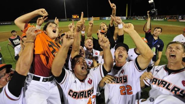 Canberra Cavalry players celebrate their win over the Perth Heat at Narrabundah Ball Park on Saturday night.