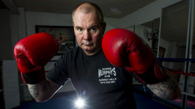 Dukes at the ready, Gerry Murphy teaches boxing to girls.