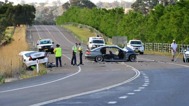 Police document the scene of a head on collision on the Barton highway between Hall and Murrumbateman on Friday.