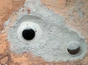 Success ... the fresh drill hole, centre, bears evidence of past water flow.