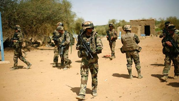 On alert ... French soldiers secure the area where a suicide bomber attempted to attack in Gao.