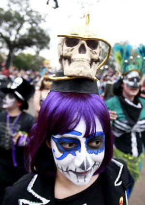 Members of the Krewe of Okeanos parade down St. Charles Avenue during the weekend before Mardi Gras in New Orleans, ...
