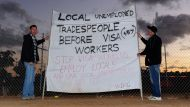 Choppers fly foreign labourers to work amid protest (Video Thumbnail)