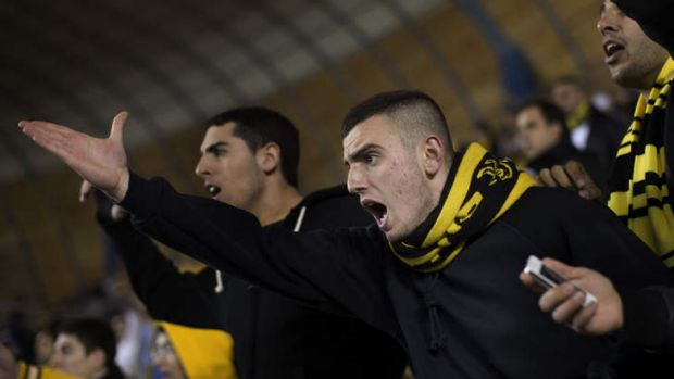 Bitter division ... Beitar Jerusalem fans watch their team play Bnei Sakhnin on Sunday.