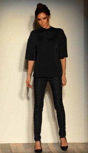 Successful ... Victoria Beckham appears on the catwalk at the end of her show.