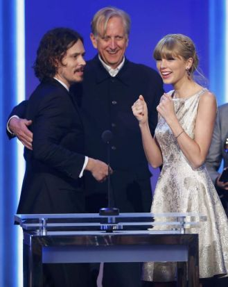 Singer Taylor Swift reacts as she accepts the Grammy award for Best Song Written For Visual Media for Safe & Sound with ...