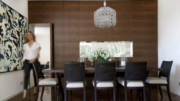 "Light fantastic … a Vistosi chandelier hangs above B&B Italia ""Maxalto"" tables and chairs in the dining area."