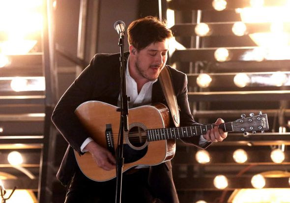 Singer Marcus Mumford of Mumford & Sons performs onstage.